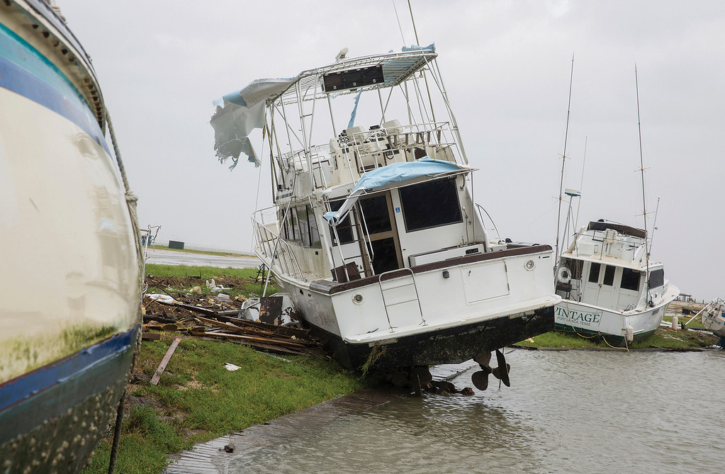 . Boats are washed up on shore at the Bayfront Pavilion Park after Hurricane Harvey hit Port Lavaca, Texas on Sunday, Aug. 27, 2017.  (Ana Ramirez/The Victoria Advocate via AP)
