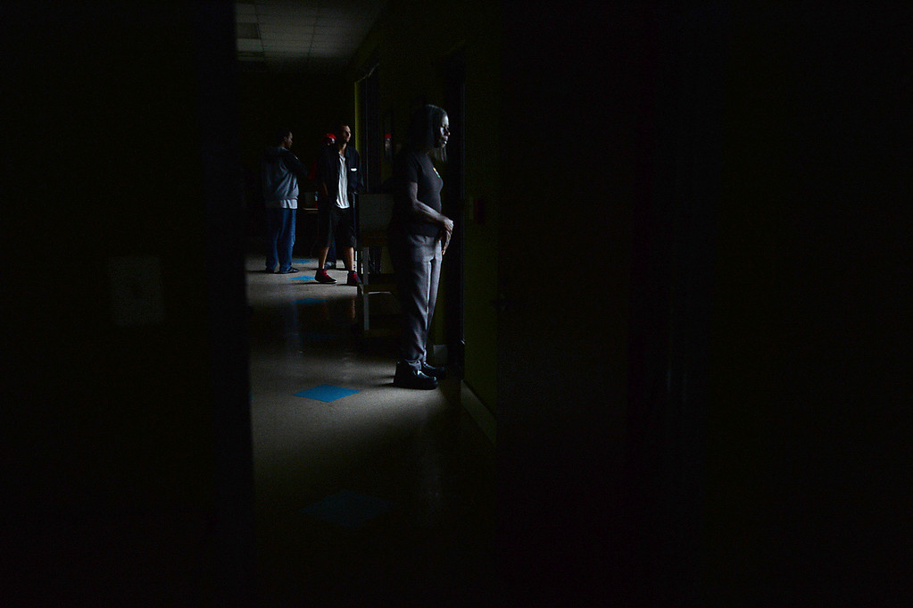 . Guests stare out the windows of the Salvation Army after the shelter lost power amid heavy rains Tuesday, Aug. 29, 2017.  Kim Brent/The Beaumont Enterprise via AP