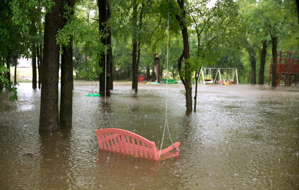 . A playground is under water at the Colorado Landing RV Park in La Grange, Texas after Hurricane Harvey on Sunday, Aug. 27, 2017. Harvey made landfall in Texas on Friday night as the strongest hurricane to hit the U.S. in more than a decade. By Saturday afternoon it had been downgraded into a tropical storm, but it had dumped over a dozen inches of rain on some areas and forecasters were warning that it could cause catastrophic flooding in the coming days. (Jay Janner/Austin American-Statesman via AP)