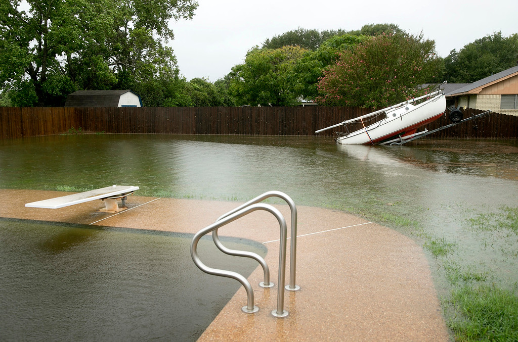 . This photo shows David Spencer\'s flooded backyard in Smithville, Texas after Hurricane Harvey on Sunday, Aug. 27, 2017. Harvey made landfall in Texas on Friday night as the strongest hurricane to hit the U.S. in more than a decade. By Saturday afternoon it had been downgraded into a tropical storm, but it had dumped over a dozen inches of rain on some areas and forecasters were warning that it could cause catastrophic flooding in the coming days. (Jay Janner/Austin American-Statesman via AP)