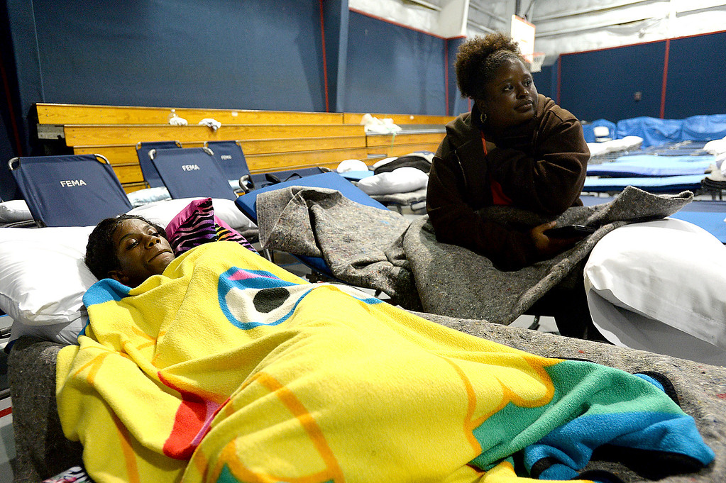 . Kori\'yana Lyons (left) and Phyllis Moore rest on their cots at the Salvation Army in Beaumont Tuesday, Aug. 29, 2017. The women were traveling to Houston from Gulfport, MS, to work with LGS Staffing in hurricane clean-up when they encountered the shut down of I-10 heading West. Kim Brent/The Beaumont Enterprise via AP