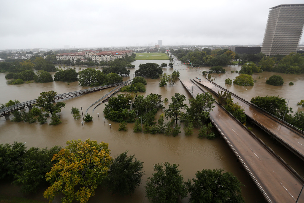 . An overhead view of the flooding in Houston, from Buffalo Bayou on Memorial Drive and Allen Parkway, as heavy rains continued falling from Tropical Storm Harvey, Monday, Aug. 28, 2017, in Houston. Houston was still largely paralyzed Monday, and there was no relief in sight from the storm that spun into Texas as a Category 4 hurricane, then parked itself over the Gulf Coast. (Karen Warren/Houston Chronicle via AP)