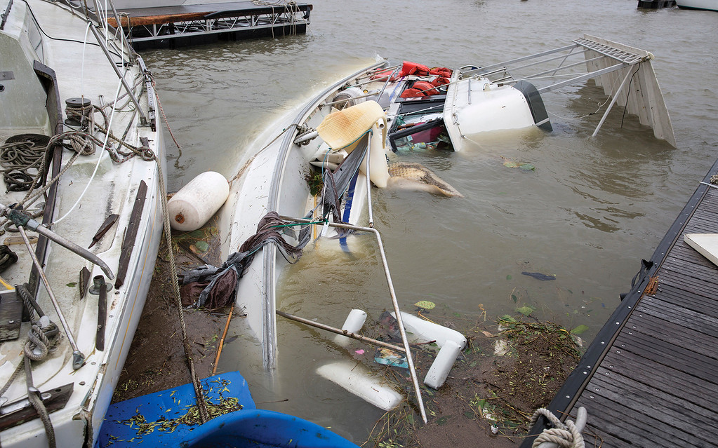. A boat lays on it\'s side almost completely underwater after Hurricane Harvey hit a harbor in Port Lavaca, Texas, on Sunday, Aug. 27, 2017.  (Ana Ramirez/The Victoria Advocate via AP)