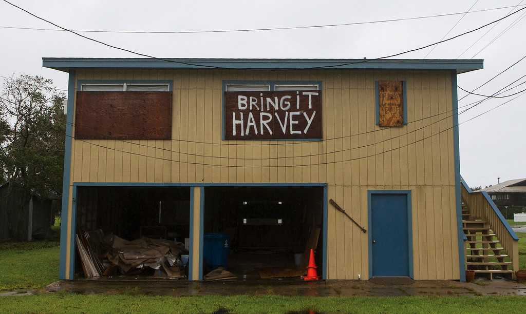 . In this Aug. 28, 2017 photo, a house in Port O\'Connor, Texas displays a message for Hurricane Harvey on one of the plywood shutters put up before the occupants fled. (Nicolas Galindo/The Victoria Advocate via AP)