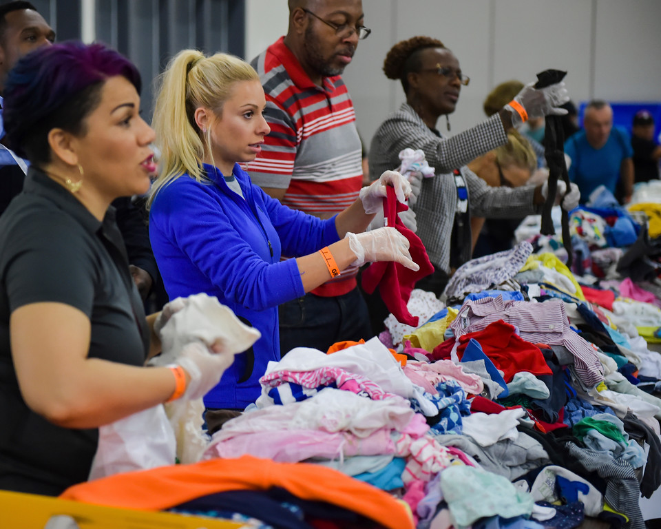 . Volunteers Elizabeth Duran and Dana Jamieson helping to sort clothes at the George R. Brown Convention Center which is being used as a shelter for residents who have been displaced by flood waters from Hurricane Harvey, Monday, Aug. 28, 2017. Houston was still largely paralyzed Monday, and there was no relief in sight from the storm that spun into Texas as a Category 4 hurricane, then parked itself over the Gulf Coast. (Scott Clause/The Daily Advertiser via AP)