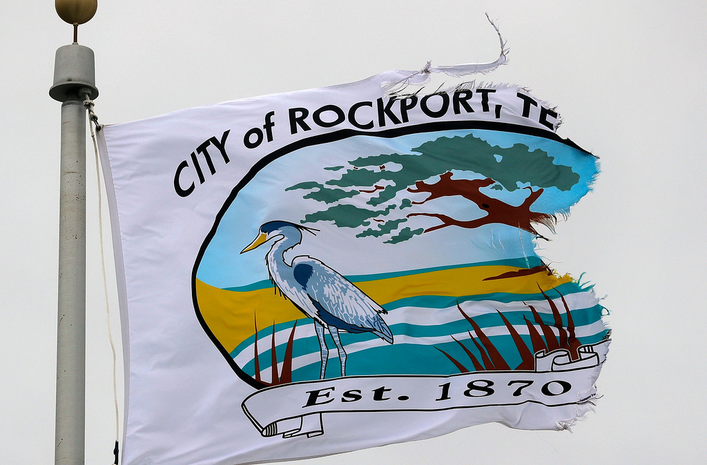 . A city flag, tattered by the effects of Hurricane Harvey, flaps in the wind over the police station, Sunday, Aug. 27, 2017, in Rockport, Texas. Tropical Storm Harvey sent devastating floods pouring into the nation�s fourth-largest city Sunday as rising water chased thousands of people to rooftops or higher ground and overwhelmed rescuers who could not keep up with the constant calls for help. (AP Photo/Eric Gay)