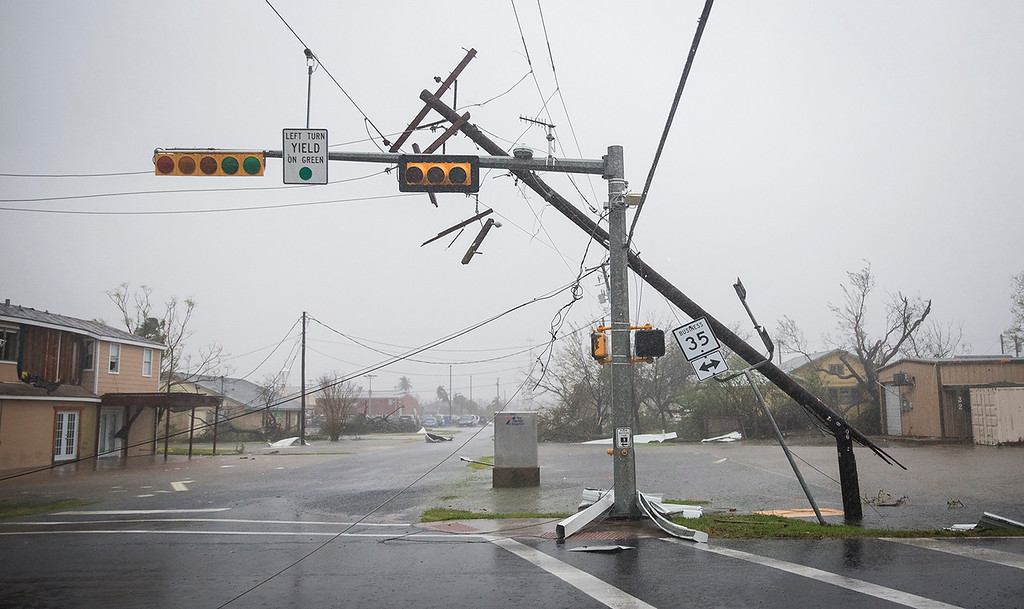 . A snapped power pole leans against a stoplight after Hurricane Harvey ripped through Rockport, Texas, on Saturday, Aug. 26, 2017.  The fiercest hurricane to hit the U.S. in more than a decade spun across hundreds of miles of coastline where communities had prepared for life-threatening storm surges � walls of water rushing inland. (Nick Wagner/Austin American-Statesman via AP)