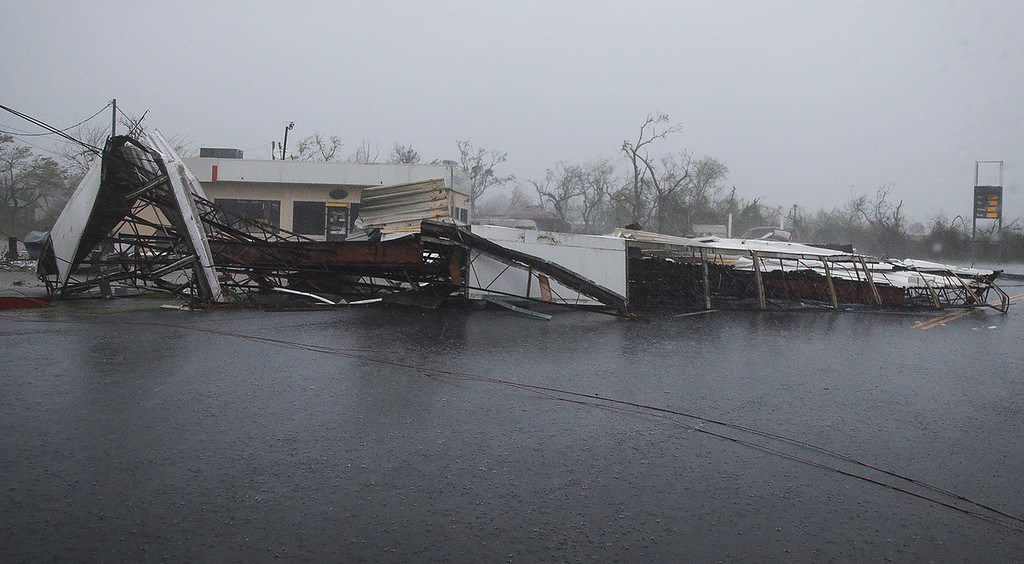 . CORRECTS SPELLING OF PHOTOGRAPHER A gas station\'s awning blocks a street after Hurricane Harvey ripped through in Rockport, Texas, on Saturday, Aug. 26, 2017.  The fiercest hurricane to hit the U.S. in more than a decade spun across hundreds of miles of coastline where communities had prepared for life-threatening storm surges, walls of water rushing inland.  (Nick Wagner/Austin American-Statesman via AP)