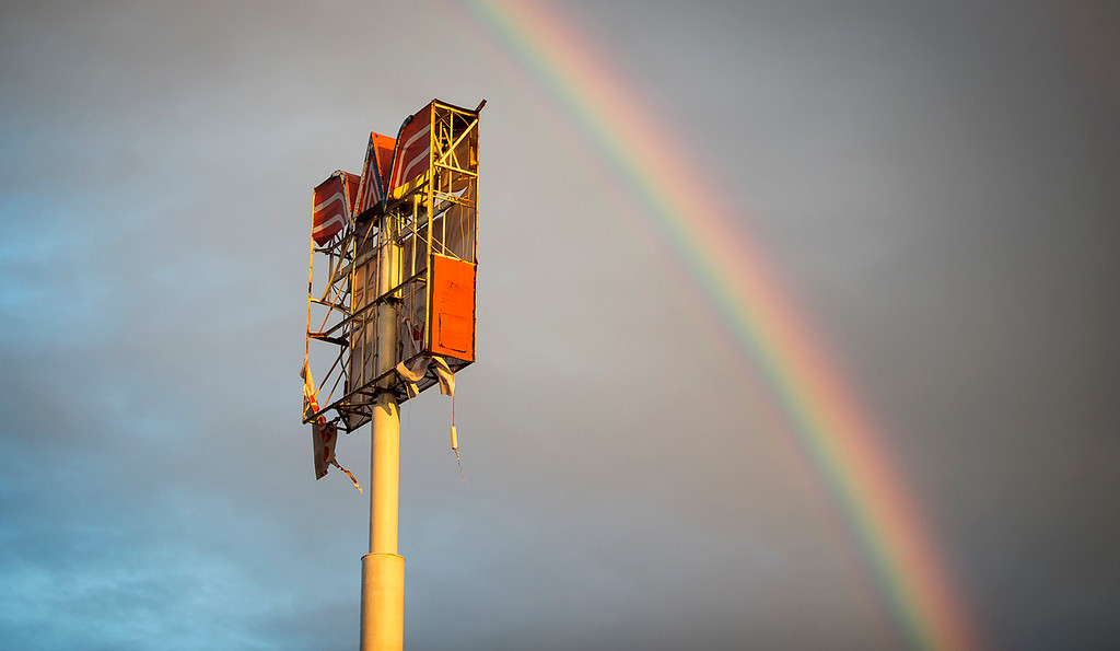 . A rainbow appears over over a Whataburger sign that was destroyed by Hurricane Harvey in Refugio, Texas, Monday, Aug. 28, 2017. (Nick Wagner/Austin American-Statesman via AP)