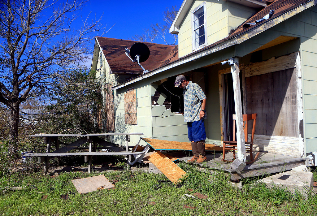 . Howard Hoffmann views his damaged home after Hurricane Harvey on Tuesday, Aug. 29, 2017, in Bayside, Texas. (Gabe Hernandez/Corpus Christi Caller-Times via AP)