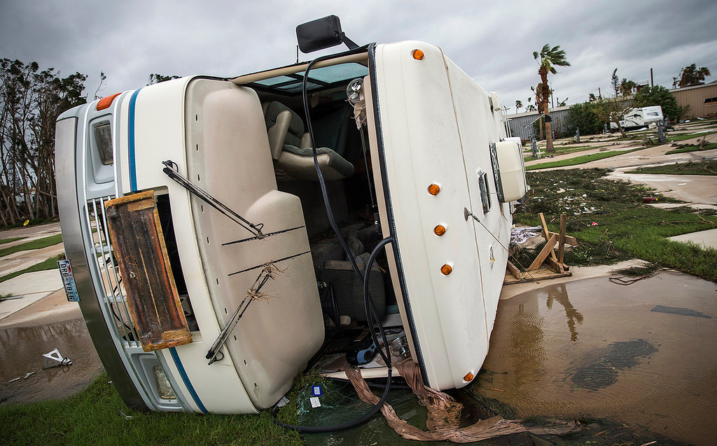 . An RV home sits on its side in Port Aransas, Texas, Sunday, Aug. 27, 2017. Harvey made landfall in Texas on Friday night as the strongest hurricane to hit the U.S. in more than a decade. By Saturday afternoon it had been downgraded into a tropical storm, but it had dumped over a dozen inches of rain on some areas and forecasters were warning that it could cause catastrophic flooding in the coming days. (Nick Wagner/Austin American-Statesman via AP)