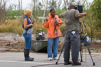 Local NBC affiliate reporter interviews a woman who was rescued from her flooding home along Hwy. 90 in eastern New Orleans.