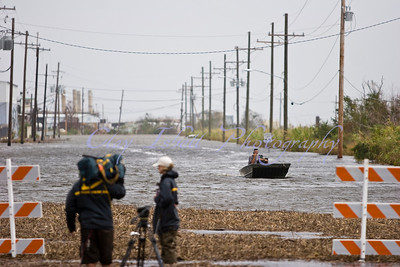 A man drives his boat down Hwy. 90 in eastern New Orleans.