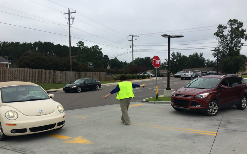 Station attendants at Murphy Express on Dorchester Road in Summerville direct a continuous flow of vehicles looking for gas and diesel Wednesday. (Photo/Andy Owens)