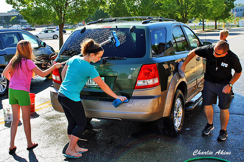 Roanoke police officers & volunteers washed cars near the event.