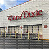 With hurricane shutters covering their windows and carts lined up Winn Dixie Store gets ready to close in preparation for Hurricane Irma .