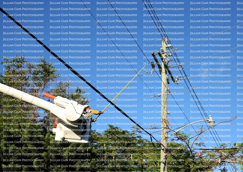 Power worker connects the main line of a residential neighborhood that was left in the dark for 6 days after Hurricane Irma hit.
