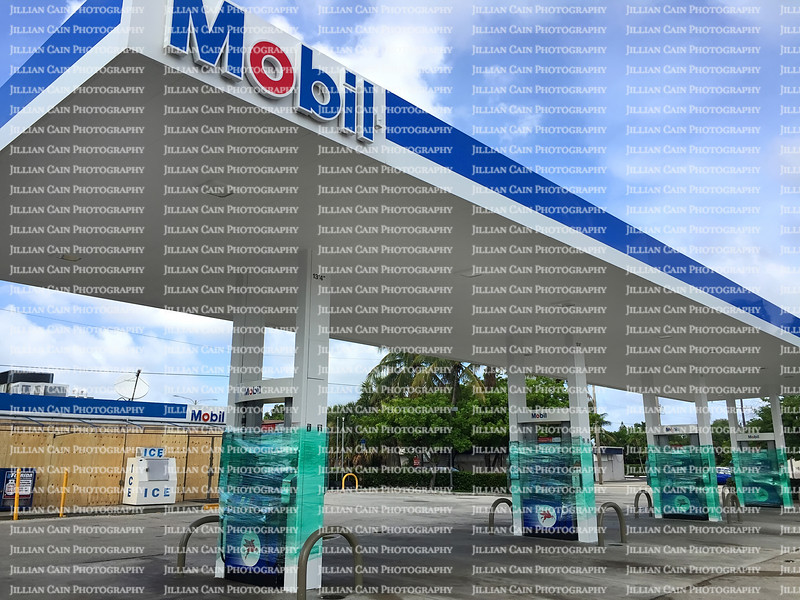 Mobil Gas Station shrink wraps their pumps after running out of gas as customers gas up for Hurricane Irma by filling their cars and gas cans.