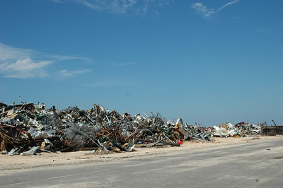 two weeks later....debris 12 feet high and 100 yards long at the Port at Gulfport