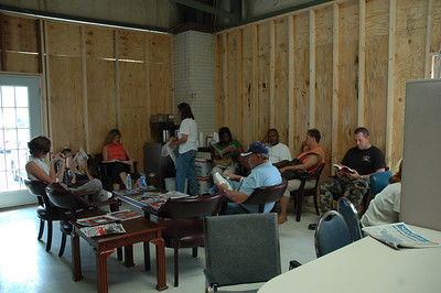 The community lingers in our showroom after being boarded back up.  This was about 2 weeks after the storm.  We were LUCKY