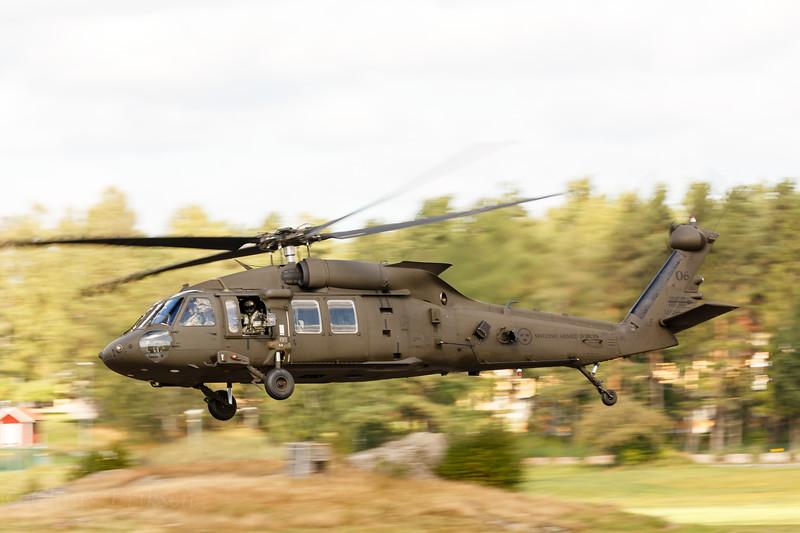 UH-60 blasting by