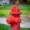 A lonely tractor looks on as the hydrant gets all the attention