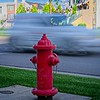 Blurry cars and a lonely fire hydrant In Daybreak, South Jordan, Utah
