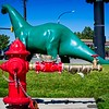 It must be a contest to see who's tail is longer. Nice try, Hydrant, but I think Dino wins.