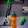 This hydrant is thinking of taking a ride on the new electric scooters scattered around downtown Salt Lake City, Utah