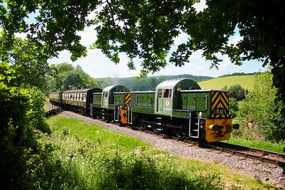 On the 11th June 2010, D9520 leads D9526 through the beautiful countryside at Nethercott in charge of a Bishops Lydeard to Minehead service.