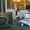 Lydia Gravell, adult services librarian, at the Lunenburg Public Library with the books she will have at her Hygge Program. Hygge is the Danish secrets to happy living and is based on a program by Meik Wiking. The program will be held on December 8, 2019 from 2-3:30 p.m. at the Lunenburg Public Library. SENTINEL & ENTERPRISE/JOHN LOVE