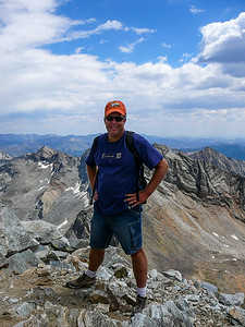 A proud man on the summit of Hyndman Peak.