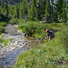 Rob tops off his water bottle in the headwaters of Hyndman Creek.