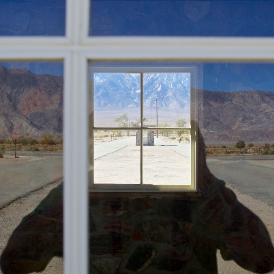 "Vane self-portrait using ""found"" mirror technique, Manzanar, CA."