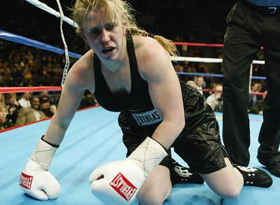 MEMPHIS, TN - FEBRUARY 22:  Tonya Harding falls to the floor during her fight with Samantha Browning in a second round during their women's bantamweight bout at The Pyramid on February 22, 2003 in Memphis, Tennessee. Browning won the fight by way of decision after 4 rounds.  (Photo by Al Bello/Getty Images)