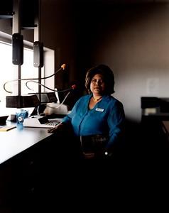 USA. Otsego, Minnesota. 2004. Gloria OSHIMA, bank teller.