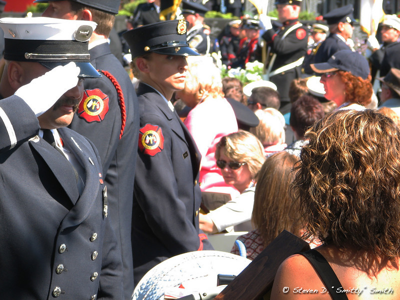 Family member of Boston Fire Departments, Lt. Kelley, receives the IAFF flag from a fellow brother.