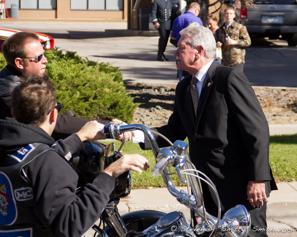 IAFF President Harold A. Schaitberger shaking hands of the motorcycle riders in the procession.