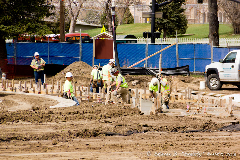 Day 50 - Workers filling forms with concrete.