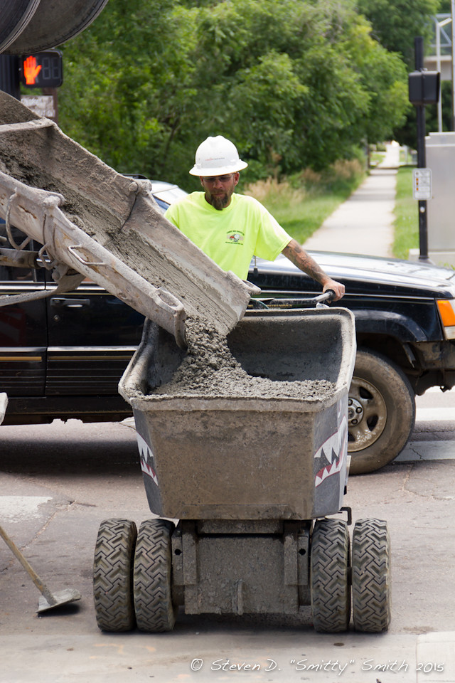Day 159 - A motorized wheelbarrow receiving concrete.