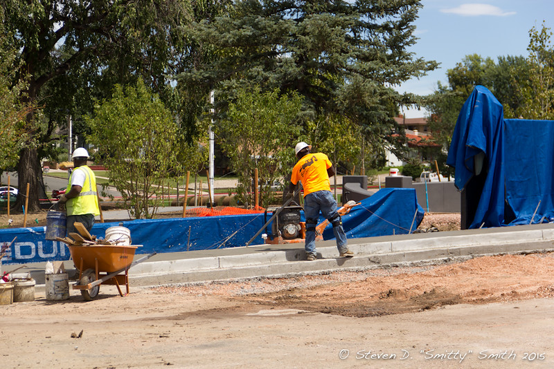 Day 169 - Finishing concrete for a sidewalk adjacent the new entry feature.