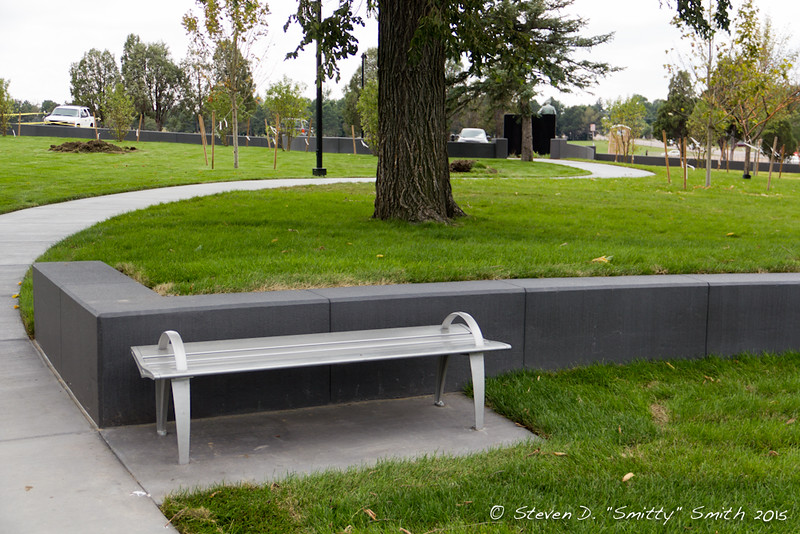 Day 192 - A bench seat along the short retaining wall just south of the main Memorial. Looking south to the main entrance of the Memorial.