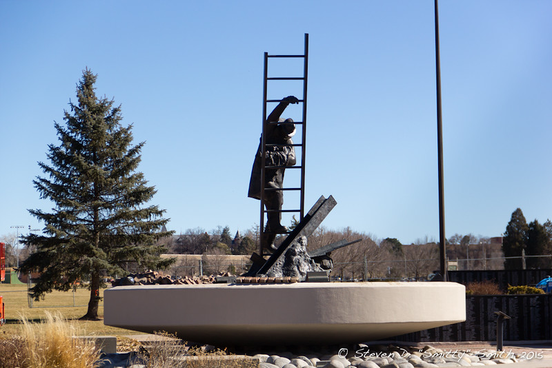 Day 5 - Brickwork around main statue base being removed and a tree (background) slated to be removed.