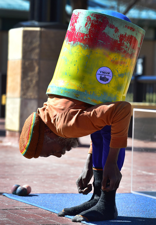 . Ibashi-I performs his stretching routine on the Pearl Street Mall in Boulder on  Wednesday. One part of the routine is to fit his body through a tube. For more photos go to dailycamera.com. Paul Aiken Staff Photographer March 7 2018