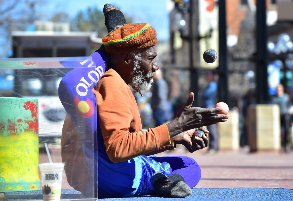 . Ibashi-I juggles in a stretch position as he tries to attract a crowd on the Pearl Street Mall in Boulder on  Wednesday. For more photos go to dailycamera.com. Paul Aiken Staff Photographer March 7 2018