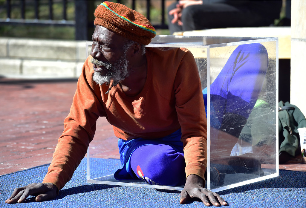 . Ibashi-I talks to the crowd as he fits himself in a box for the finale of his stretching routine on the Pearl Street Mall in Boulder on  Wednesday. For more photos go to dailycamera.com. Paul Aiken Staff Photographer March 7 2018
