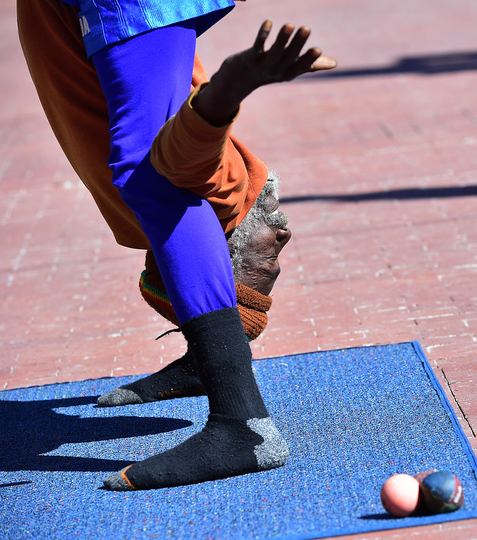 . Ibashi-I performs his stretching routine on the Pearl Street Mall in Boulder on  Wednesday. For more photos go to dailycamera.com. Paul Aiken Staff Photographer March 7 2018