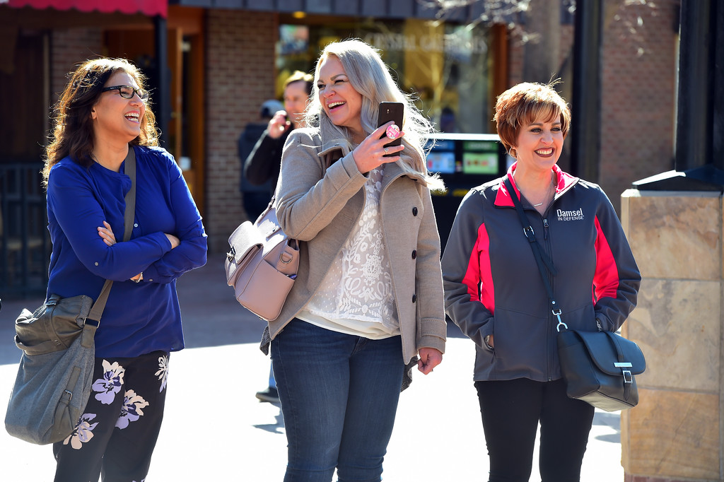 . From left to right, Cheryl Lacy, Mindy Lin and Paula McCune watch Ibashi-I perform his stretching routine on the Pearl Street Mall in Boulder on  Wednesday. For more photos go to dailycamera.com. Paul Aiken Staff Photographer March 7 2018