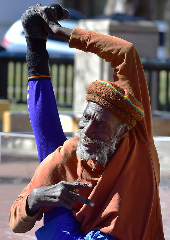 . Ibashi-I poses for photos from his crowd as he performs his stretching routine on the Pearl Street Mall in Boulder on  Wednesday. For more photos go to dailycamera.com. Paul Aiken Staff Photographer March 7 2018