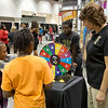 Indiana Black Expo IBE 2014. Attendees spin the wheel to answer Black history questions posed by Purdue Black Cultural Center director Renee Thomas. ( Purdue University/ Mark Simons)